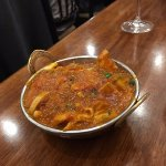 Chicken Jalfrezi with tomatoes, onion and mixed vegetables, finished with lemon juice.