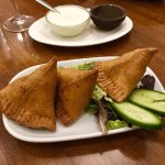 Vegetable Samosa Lightly spiced potatoes and peas filling wrapped in homemade pastry.