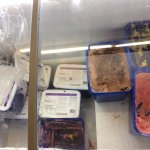 Ice cream stored with no lids, unidentified food stuffs at bottom of filthily freezer