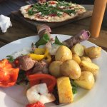 Pizza and lamb and prawn skewers