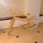 A wooden bicycle in the restaurant!