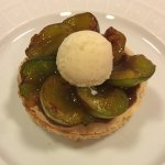 Almond cake with plums and vanilla ice cream
