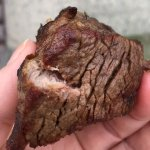 1 of 2 photos showing charcoal/ burned filet mignon on one side and correctly cooked on other. S