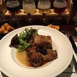 Rabbit with prunes accompanied by beer sampler