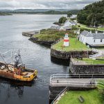 A trawler leaves the sea lock - taken from the top floor of the Crinan Hotel