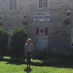 Emilie was happy to pose in front of the museum....the swinging bridge is very close too!