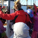 The kids were invited to help hoist the sails.