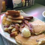 The Cadillac Two eggs, two strips of bacon, two links and two buttermilk pancakes with homefries