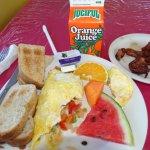 Omelette, Bacon, toast, papaya & watermelon