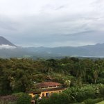 View of Arenal Lodge with volcano and lake in the background