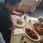 Wife with her platter and our son with the sweet and sour pork