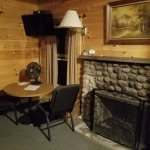 Fireplace and table in Cabin #6