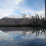 Dining table view in a guest villa. Reflection of Cecil Peak