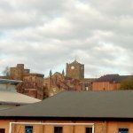 Towers and pinnacles jutting over Hexham rooftops, from railway station
