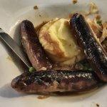 Burnt trio of sausages.