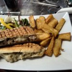 Roast pork Panini with chips and salad