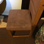 Dirty and stained carpet.  The fabric on the chairs was stained and dirty.  Broken furniture, sh