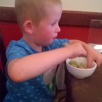 Sam enjoying his banana fritters, ice cream and bubble gum sauce :)