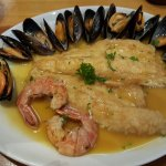 Sea bass fillets, prawns ans mussels, with side of small potatoes