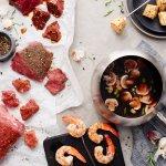 Land & Sea fondue entree cooking in our Coq Au Vin fondue style