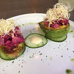 Avocado filled with beets salad