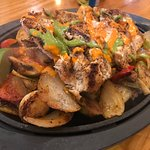 Chicken fajitas with red and green peppers, onions, as well as grilled Mexican squash, Brussel s