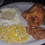 Broasted chicken with homemade mashed potatoes and gravy and corn