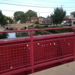 This bridge carries the Monan trail over the canal. Patio of Bistro over the handrail.