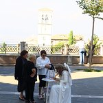 A lady dressed as an angel signing cards in the square!