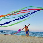 Flying kites at the Asterias Beach Hotel