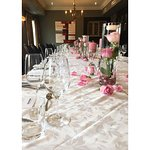 Tables are Set for a Wedding to Begin