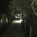 The walkway to the rooms is lit at night