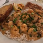"""""""Grouper Kevin"""" contained pan seared grouper and a shrimp and mushroom sauce over rice."""