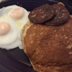 basted eggs, sausage patties and pancakes