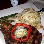 14 oz. Ribeye, scalloped potatoes topped with gorgonzola cheese, & asparagus
