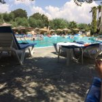 Pool side by day. Plenty of shade under the olive trees or sunshades.