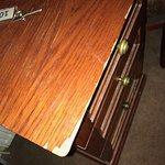 Broken, missing and buckled veneer on dressing table