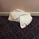 Clean towels on the dirty corridor floor