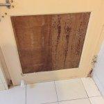 busted up bath room door