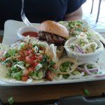One fish taco, one slider, slaw and caesar salad.