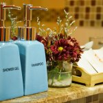 Ceramic bottle of shampoo, shower gel and other toiletries in every room