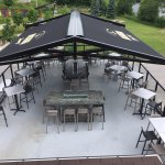 new top floor awning over granite fire tables