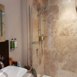 Good shower with large shower head plus regular shower. Equipped with soap dispensers etc