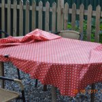Black stained plastic cloth on outside table.