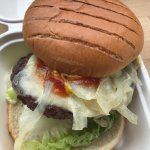 Beef burger with cheese and onions