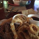 Fried onion rings, cole slaw and BBQ sauce