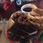Slab of brisket, onion rings, and fried okra