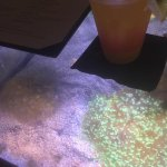 The bar top is a working fish tank. Fish, like this clown fish, swim underneath your drinks!