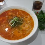 Spicy noodle soup with king prawns