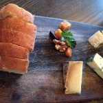 Three cheese plate with dried fruit and nuts